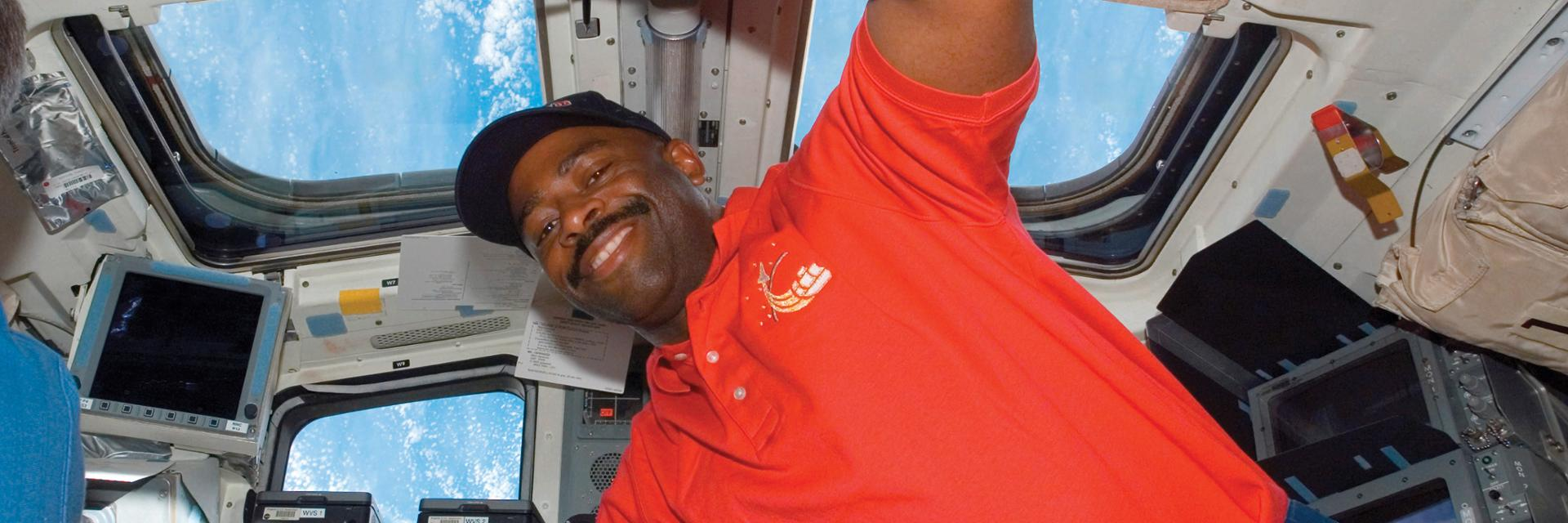 Leland Melvin floats aboard the International Space Station