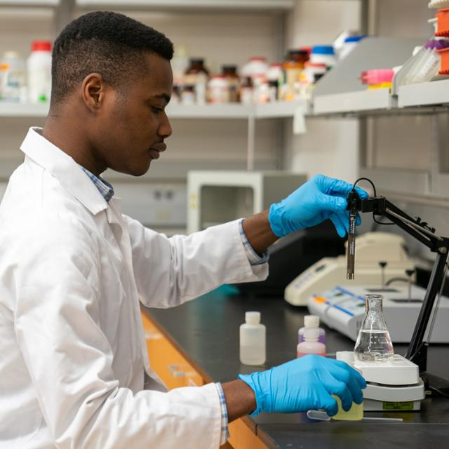Henry Dwaah working in a lab