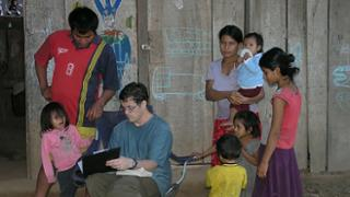 Leadership studies professor and anthropologist Chris von Rueden with Tsimane people in the Bolivian Amazon