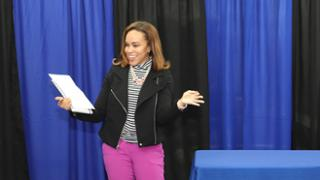 Kimberly Bowers Rollins speaking at a Goodwill of Greater Washington graduation