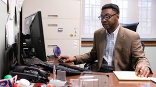 Professor Ernest McGowen at work