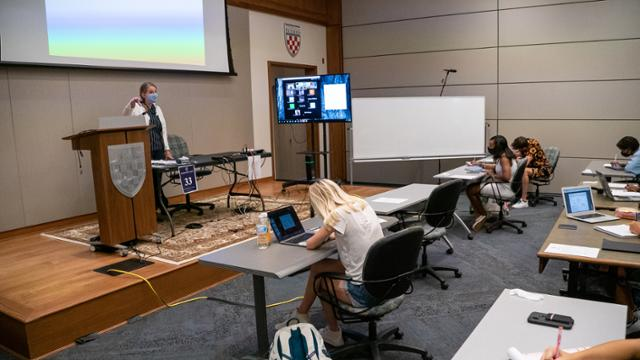 Professor Julie Pollock teaches a class to in-person and remote students