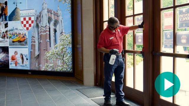 Staff member cleaning window