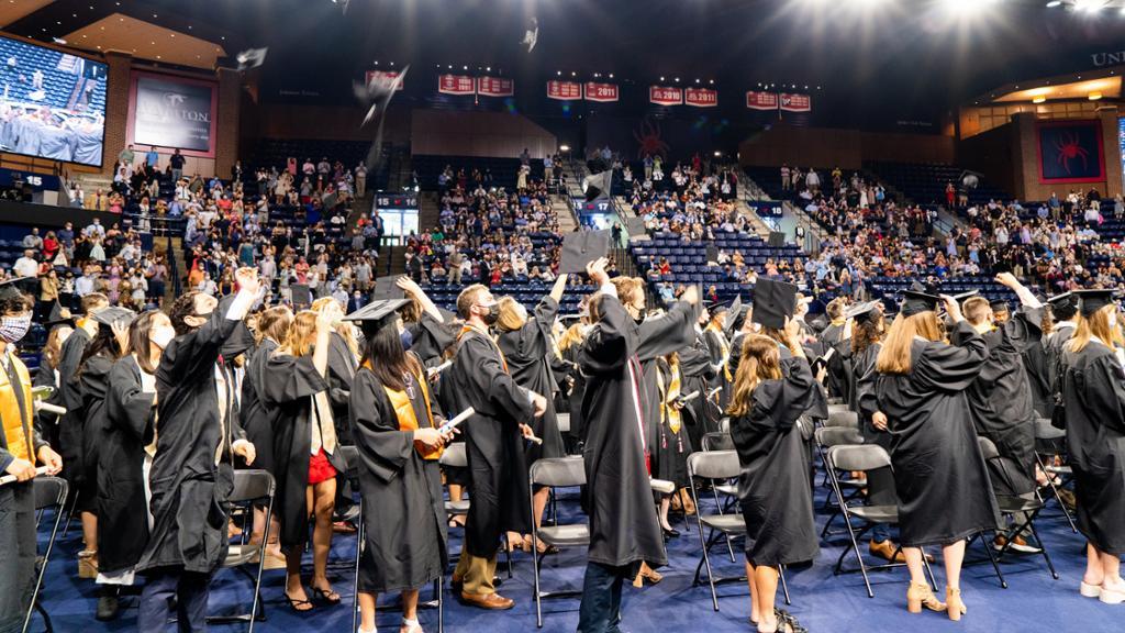 Class of 2020 grads throw their caps