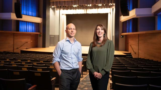 andy and joanna in a theater