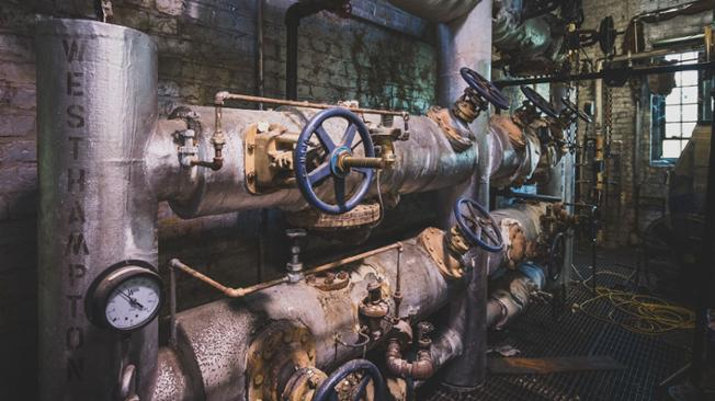 An interior photograph of the steam plant, showing the name