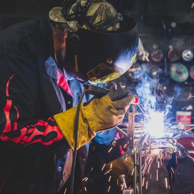 Boiler mechanic, Chris Weaver at work in the metal shop