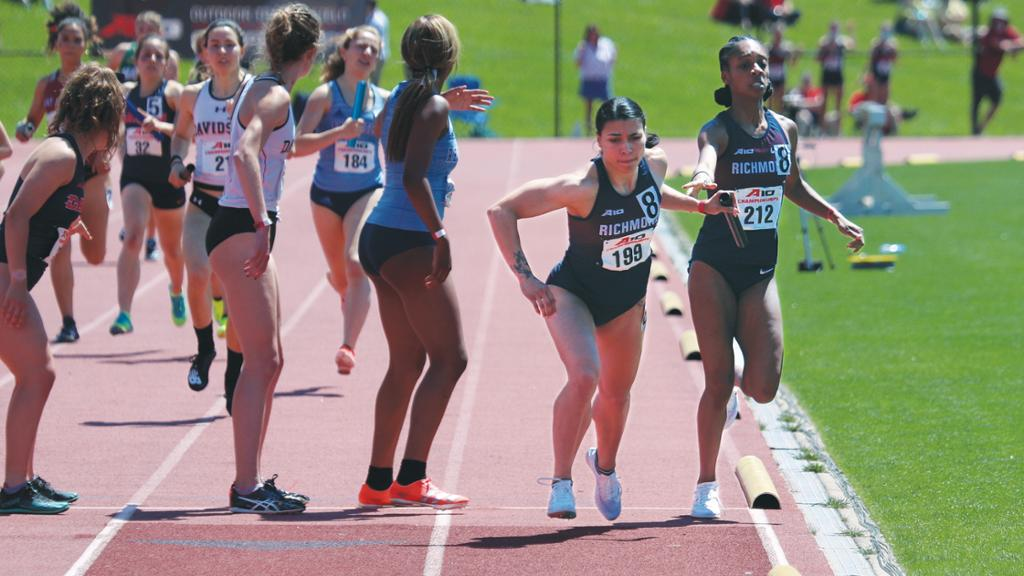 Kendra Smither,¿ far right, hands off the baton to Maria Acosta during the A-10 2021 outdoor championships.