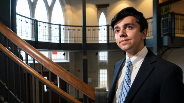 Julien Wadhwa stands in the foyer of the Robins School of Business.