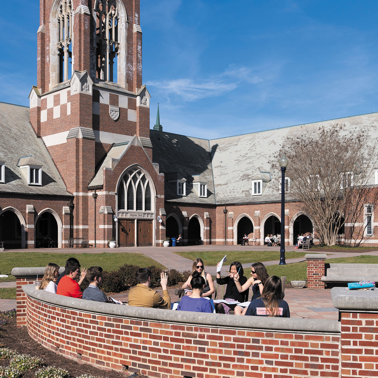 A professor and students hold a class outside on Stern Quad.
