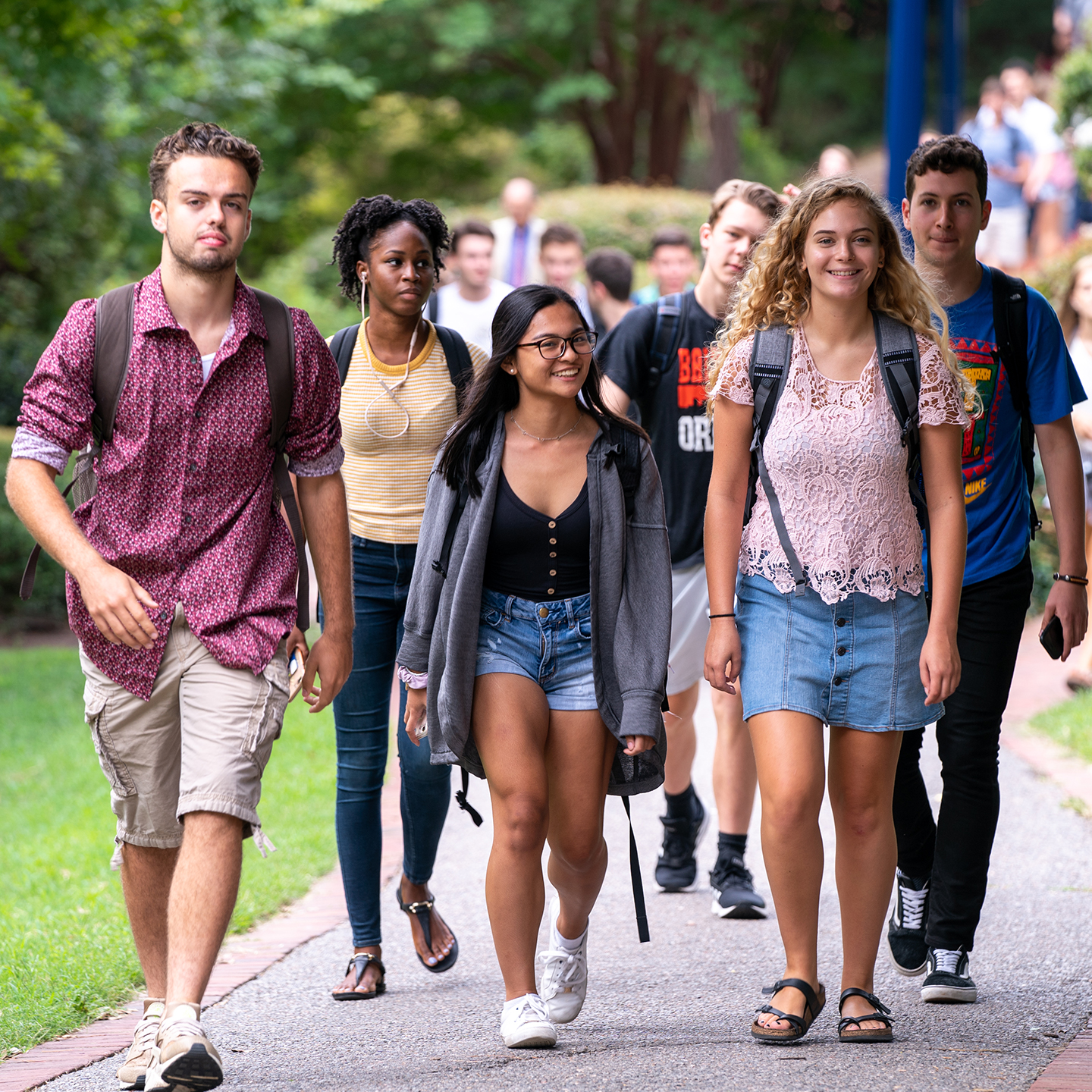 Students walk across campus between classes.