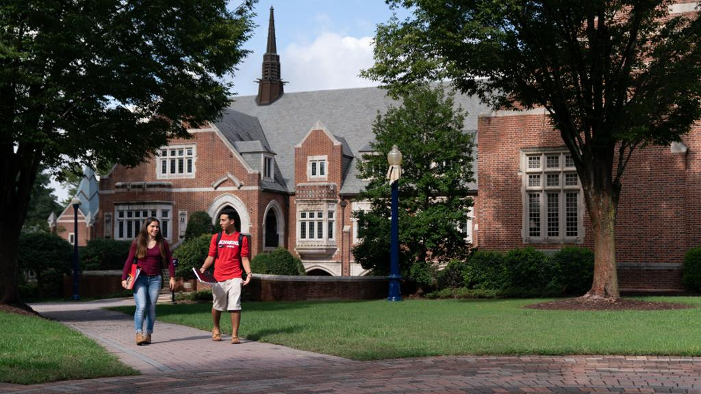 Two students walk across campus.