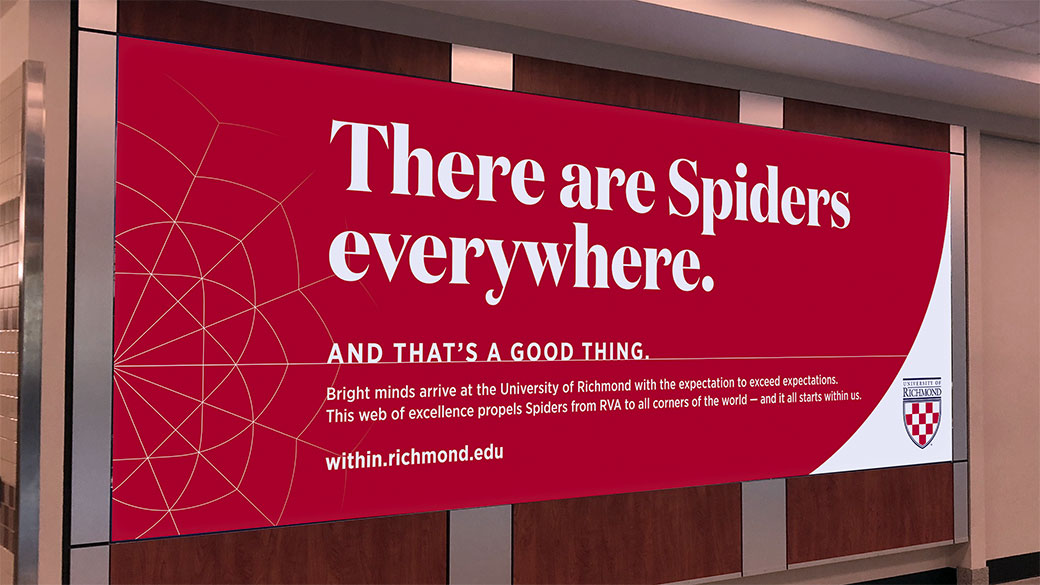 "Large advertisement at the Richmond airport that states, ""There are Spiders everywhere. And that's a good thing."""