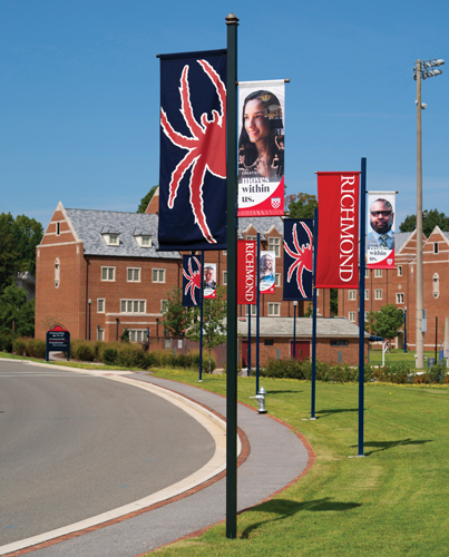 Several campus banners along the road.