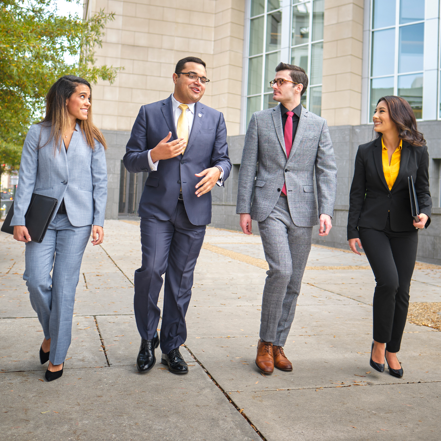 Students walking downtown in business attire