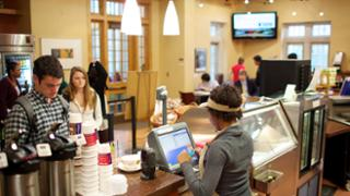 Student paying for meal in Passport Cafe