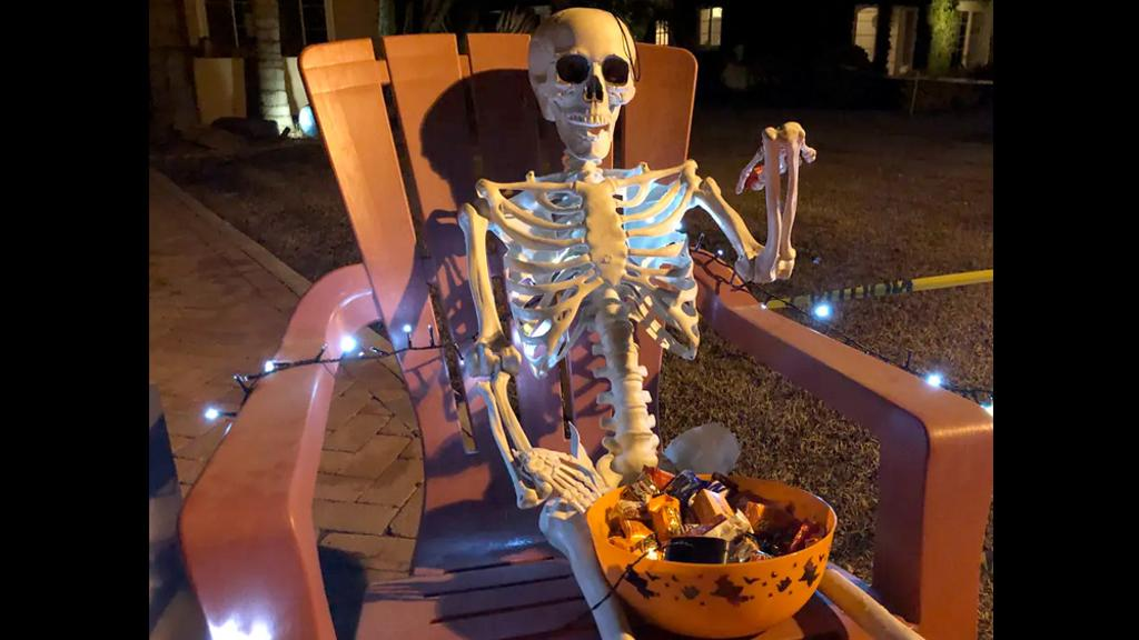 Skeleton with candy bowl