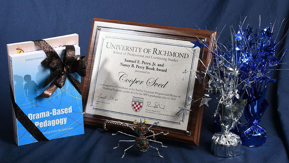 Awards plaque and books for Cooper Sved