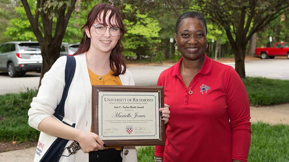 Marielle Jones receiving award plaque from Dean Wilson