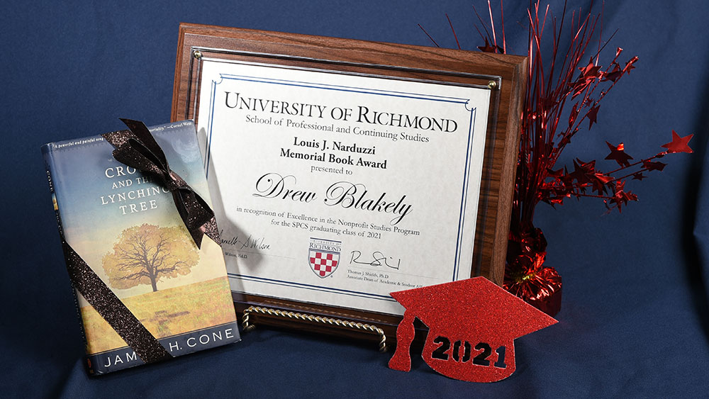 Blakely's award plaque and book