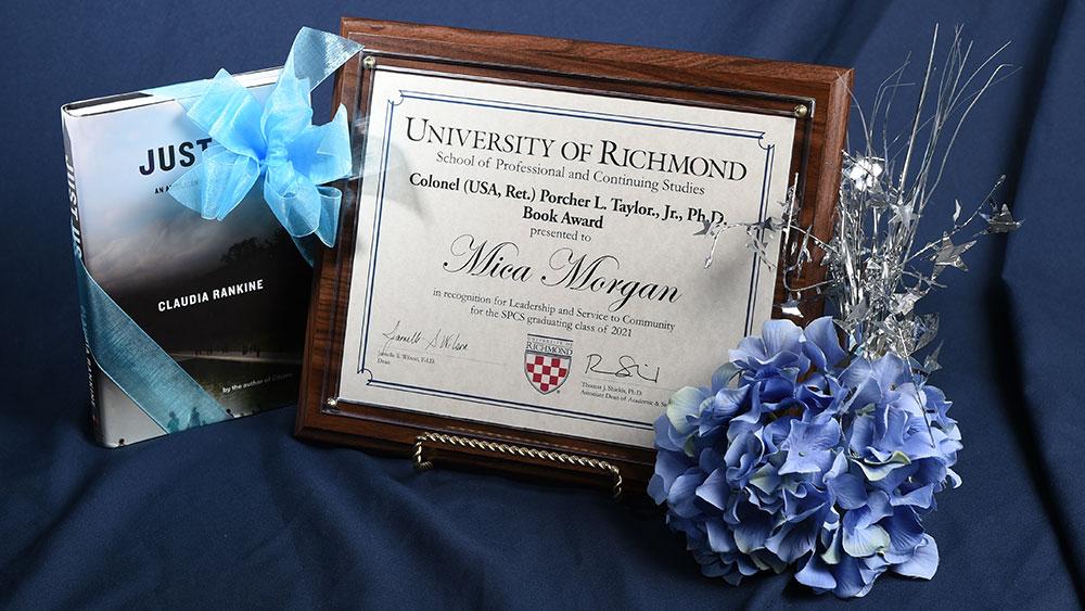 Morgan's award plaque and book