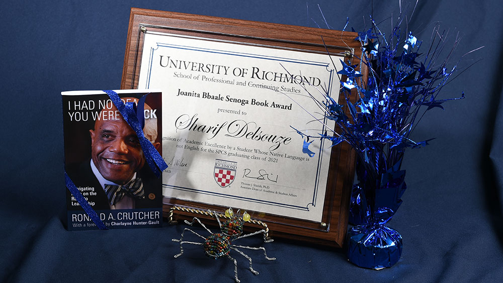 Delsouze's award plaque and book