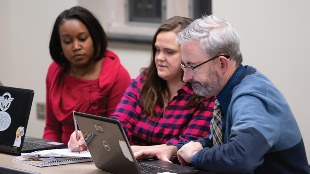 Students concentrating on a group project