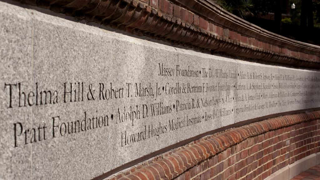 Donor names engraved on a wall.