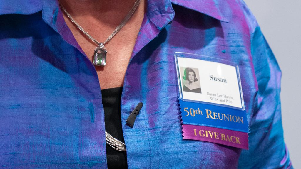 Alumna wearing a reunion volunteer badge.