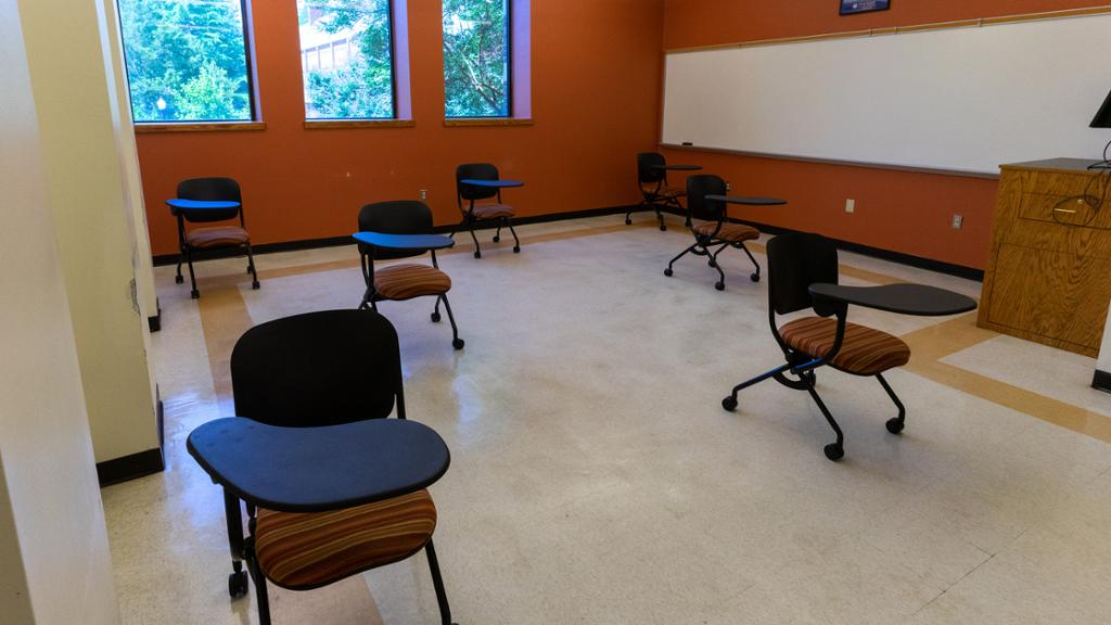 Interior of a classroom where the desks and chairs have been spaced out to provide at least six feet separation.