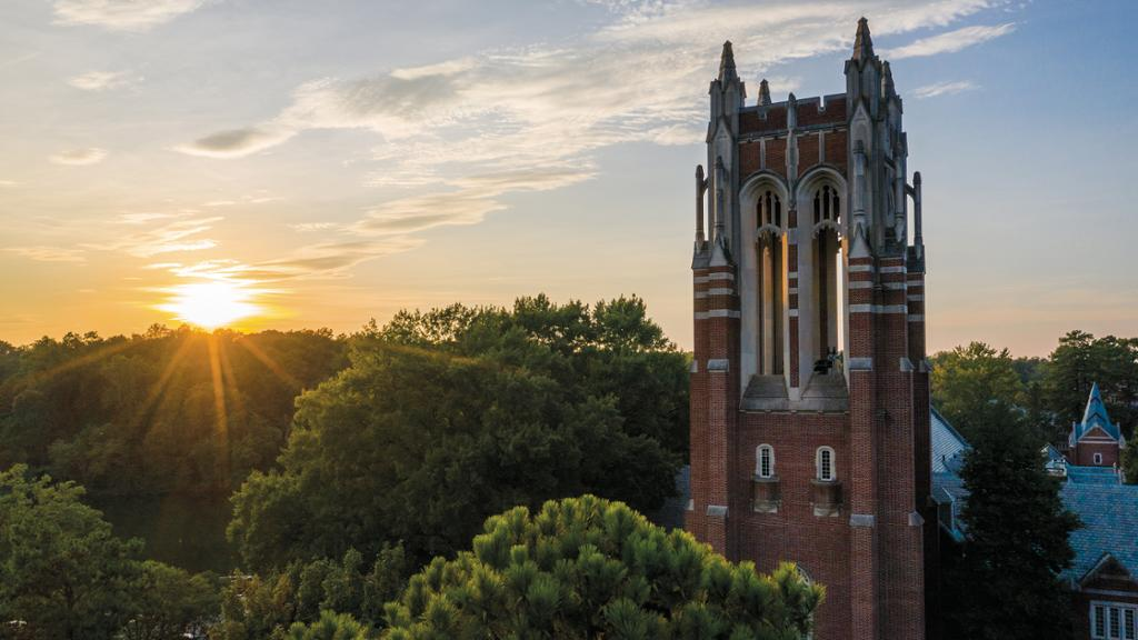 The sun sets behind Boatwright Tower.