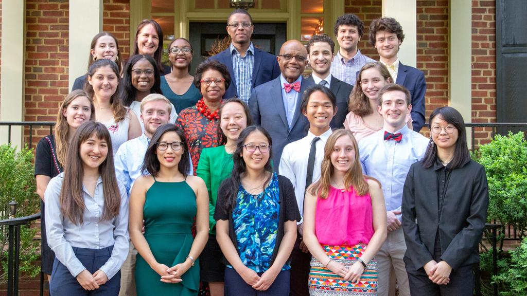 Dr. Ronald Crutcher stands with a group of student scholars.