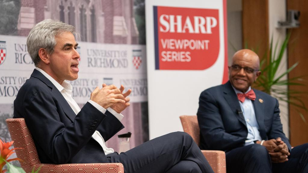 Dr. Crutcher and a guest at the Sharp Speaker Series.