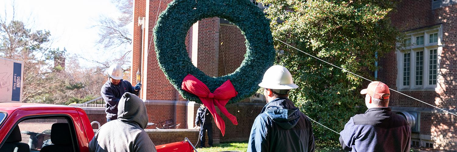 Boatwright Memorial Library adorned with three holiday wreaths