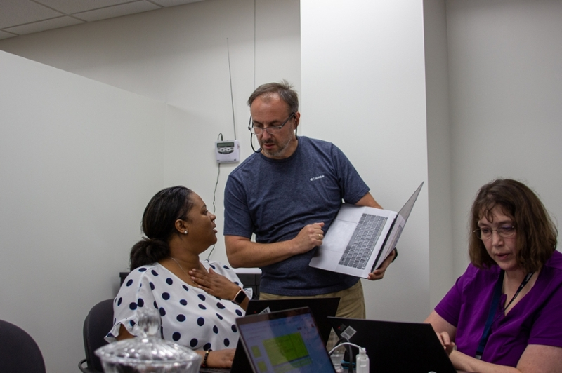 Programmers, system administrators, and network specialists work together to upgrade our systems.
