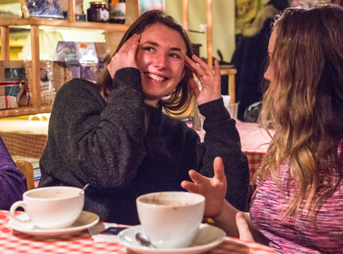 Rylin McGee smiling and drinking tea with friends in Russia