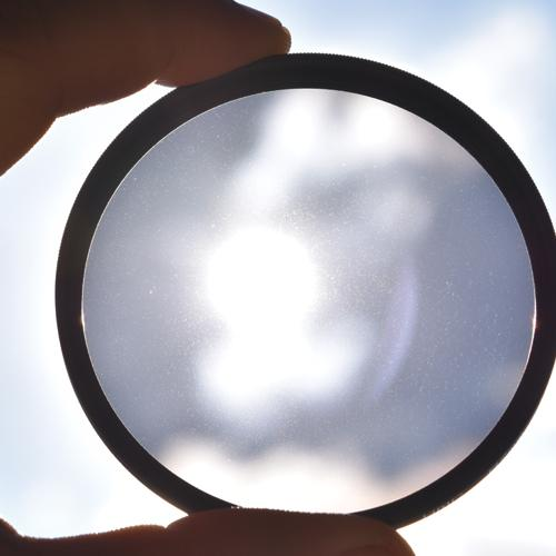 Looking through clear lens at sky