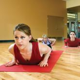 Women stretching on floor mat